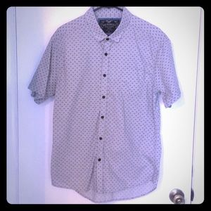 Short sleeve button up shirt with bicycle print